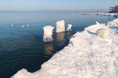 Ice-covered breakwater. Baltic sea — Stock Photo