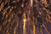 Long exposure fireworks against a black sky — Foto de Stock