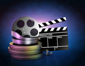 Movie film reels and cinema clapper — Stock Photo