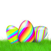 Colorful easter eggs in the green grass — Stock Photo
