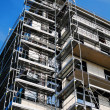 Scaffolding construction with blue sky — Stock Photo #26572653