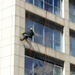 Steeplejack works, cleaning facade — Stock Photo #27279295