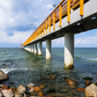 Stock Photo: Concrete pier or Jetty on beach