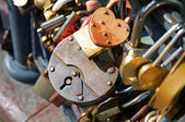 Many Love locks on the bridge — Stock Photo