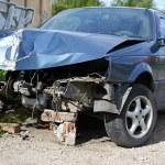 A blue wrecked car — Stock Photo #38957573
