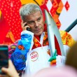 Russian singer, composer and poet Oleg Gazmanov participates in relay of Olympic Flame on October 29, 2013 in Svetlogorsk, Russia — Stock Photo