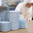 Clean dishes in a restaurant kitchen — Stock Photo #38965445