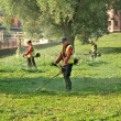 Workers mow the grass — Stock Photo