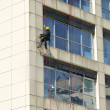 Steeplejack works, cleaning facade — Stock Photo #38973801