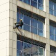 Steeplejack works, cleaning facade — Stock Photo #38973803