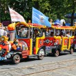 Colorful train transporting children with parents on Celebration Day of the city Kaliningrad, Russia — Stock Photo #38974883
