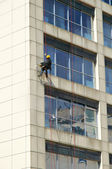 Steeplejack works, cleaning facade — Stock Photo