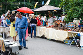 Street trade in goods of folk art at celebration day of the city Kaliningrad, Russia. — Stock Photo