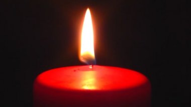 Single red candle burning — Stock Video
