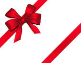 Red shiny bow with ribbon — Stock Photo