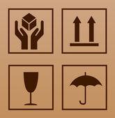 Fragile symbol on cardboard — Stock Vector