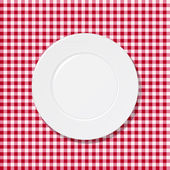 White plate on tablecloth — Stock Vector