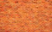 オレンジ色のレンガの壁 — ストック写真