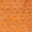 Stock Photo: Lamp on orange brick wall