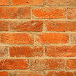 Close up of orange brick wall — Stock Photo