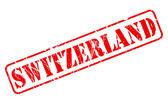 Switzerland red stamp text — Stock Vector