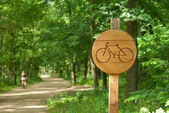 Bicycle lane sign indicating bike route wooden — Stock Photo