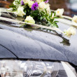 Stock Photo: Wedding car decorated with flowers
