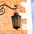 Old lantern Sukiennice (Cloth Hall) square in town Krakow Poland — Stock Photo #12600843