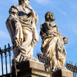 Stock Photo: Stone statues Cracow -St. Peter's and St. Paul's Church