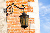 Old lantern Sukiennice (Cloth Hall) square in town Krakow Poland — 图库照片