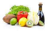 Fruits and vinegar bottle — Stock Photo