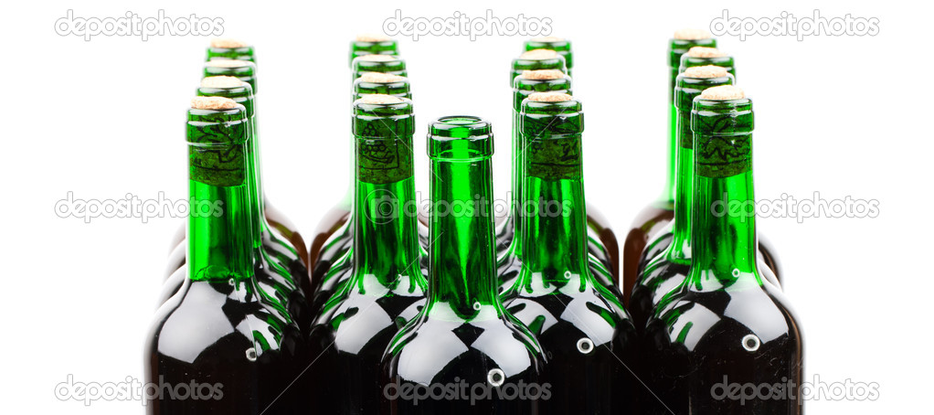 Wine bottles with corks on white background — Stock Photo #13381564