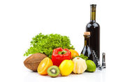 Fruits and wine bottles — Stock Photo