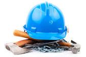 Blue helmet and carpenter tools — Stock Photo