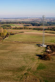 Aerial view of radio tower on meadow landscape — Foto Stock