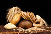 Baked bread on wooden table — Стоковое фото