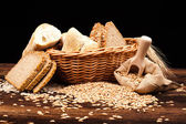 Baked bread on wooden table — Stock Photo