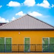 Stock Photo: Red roof with blue sky