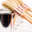 Cans of paint with paintbrushes isolated on white — Stock Photo #16860039