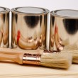 Cans of paint with paintbrushes isolated on white — Stock Photo
