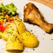 Roast chicken on plate with potatoes and salad — Stock Photo