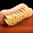 Cleaning brush on wooden table — Stock Photo