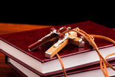 Crosses and holly books on black background — Stock Photo