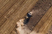 Aerial view of combine on harvest fields — Stock Photo