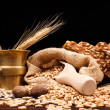 Baked bread, wheat and brass mortar — Stock Photo