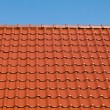 Red roof with blue sky — Stock Photo