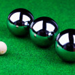 Steel balls on green surface — Foto de Stock