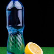 Bottle of water and lemon — Stock Photo
