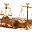 Law book, money, magnifying glass and scales of justice — Stock Photo