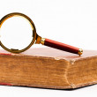 Law book and magnifying glass — Stock Photo